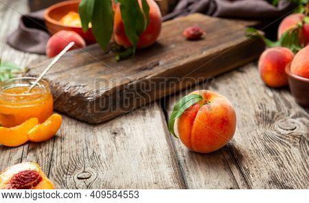 Still Life Peach Dark Key. Peach Fruit Harvest. Juicy Ripe Peaches On Dark Wooden Rustic Table. Deli