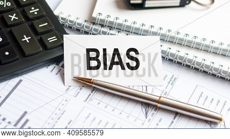 Writing Text Bias On White Paper Card, Black Letters, Pen And Diagram On White Background. Business