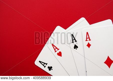 Four Poker Cards Of Aces On Red Background. Four Playing Cards Of Aces.