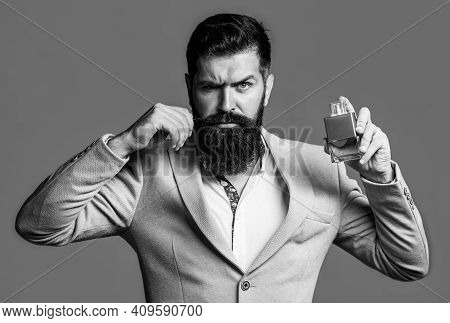 Fashion Cologne Bottle. Bearded Male Prefers Expensive Fragrance Smell. Man Perfume, Fragrance. Masc