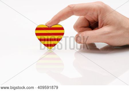 Flag Of Catalonia. Love And Respect Catalonia. A Man's Hand Holds A Heart In The Shape Of The Catalu