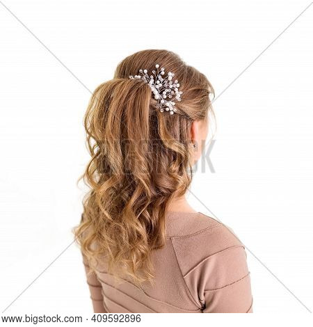 Wave Curls Hairstyle. Hairstyle On Blond Hair Woman With Long Hair On A White Background. Profession