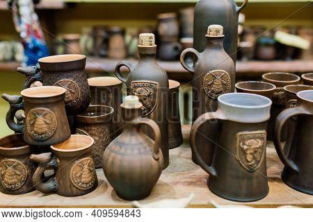 Handycraft Clay Brown Tableware, Earthenware Jug In Pottery Workshop. Ceramics Product Concept.