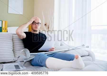 A Worried Man With A Broken Leg Reviews The Test Results.