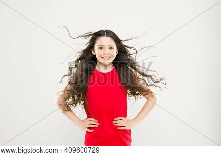 Perfect Curls. Kid Cute Face With Adorable Curly Hairstyle. Little Girl Grow Long Hair. Teen Fashion