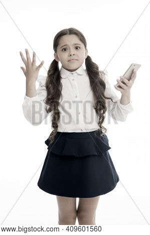 Girl Cute Long Curly Hair Holds Smartphone White Background. Child Desperate Helpless Face Expressio