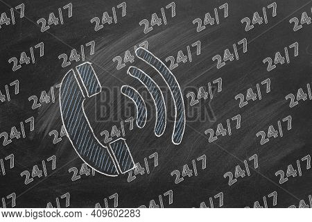 Phone Icon And Lettering 24-7 Drawn In Chalk On A Blackboard. Contact Center, Call Center, Service C