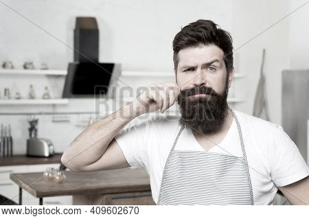 Curling His Long Moustache. Professional Cook Confident In His Cooking Skills. Bearded Man In Kitche
