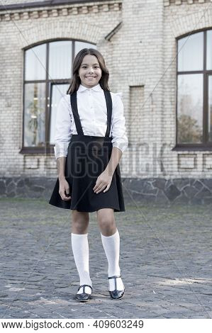 School Fashion. Girl Wear Fashionable Outfit. White Shirt And Black Dress. Classic Style. Formal Clo