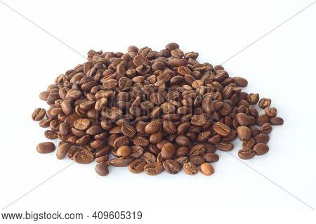 A Pile Of Coffee Beans Isolated On White Background. Roasted Arabica Coffee Beans.