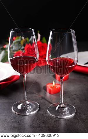 Beautiful Place Setting For Romantic Dinner On Grey Table