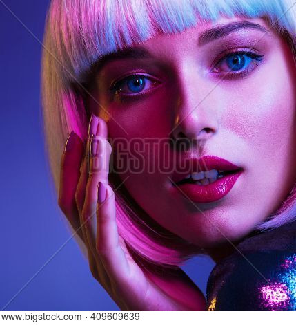 Glamour fashion girl. Beauty face with bright makeup. Young beautiful woman in a white wig, bob hairstyle. Close up art portrait  of  an young attractive woman with vivid colors. Stylish blonde.