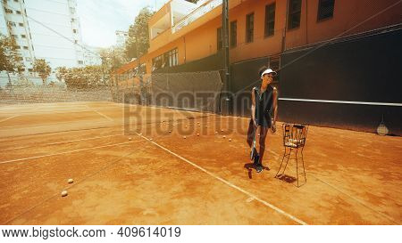Laughing Slim Young African-american Female In Sportswear And With A Racket In Her Hand Has Just Fin