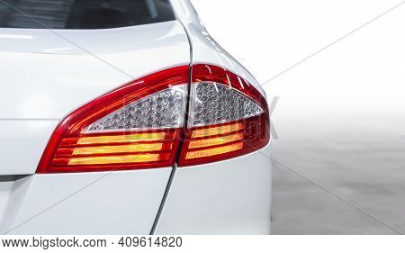 The Back Of A White Expensive Crossover Car:  Bumper, Trunk Lid, Taillight On The Back White Backgro