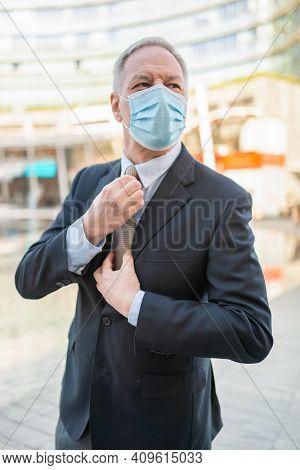 Portrait of a covid coronavirus masked businessman, management concept