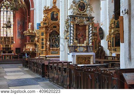 Torun, Poland - December 01, 2016: Interior Of The Gothic Catholic Church Of St. John The Baptist An