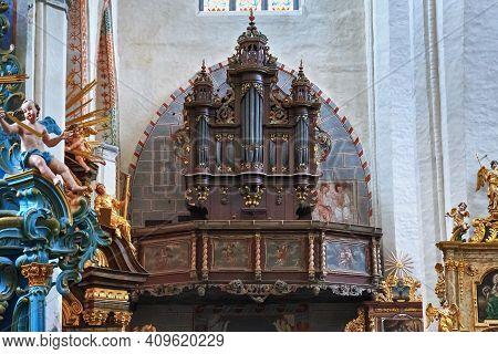 Torun, Poland - December 01, 2016: Pipe Organ In The Gothic Catholic Church Of St. John The Baptist
