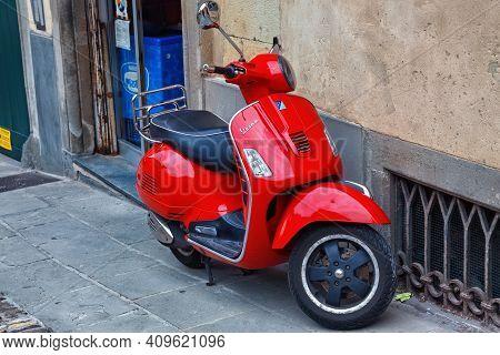 Bergamo, Italy - May 22, 2019: Red Popular Italian Scooter Vespa On The Street In Bergamo.