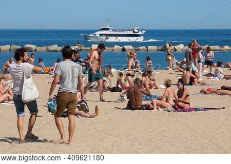 Barcelona, Spain - May 15, 2017: Unknown People Resting And Sunbathing On A City Beach In Barcelona.