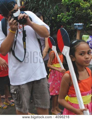 A Photographer During A Parade
