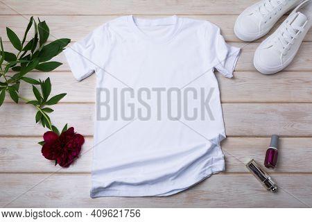 Women's T-shirt Mockup With Burgundy Peony And Nail Polish
