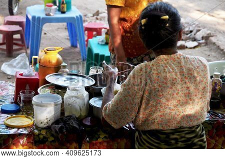 Burmese Women Vendor Sale And Cooking Street Food For Burma People And Foreign Travelers Select Buy