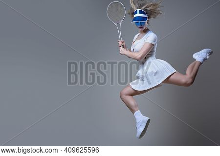 Caucasian Female Tennis Player Dressed In White Sportswear With Blue Cap Poses In White Background J