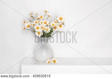 A Bouquet Of Daisies In A White Glass Vase On A White Table, Flowers For Grandmother's Birthday, For