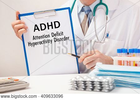 Doctor Holds Paper With Inscription - Adhd - Attention Deficit Hyperactivity Disorder, Stethoscope A