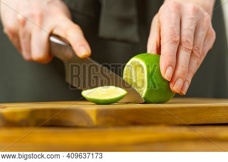 Woman Cutting Lime In Kitchen, Lemon Water, Refreshing Water With Lime And Lemon, Healthy Eating Con