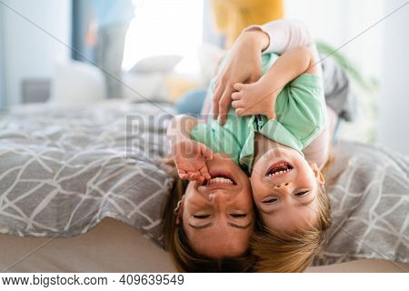 Happy Little Toddler Boy Having Fun With His Mother At Home. Single Parenting, Happiness Concept.