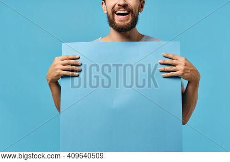 Emotional Man Holding Mocap Poster Copy Space Advertising Marketing In Hand