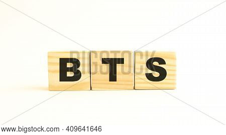 The Word Bts. Wooden Cubes With Letters Isolated On White Background. Conceptual Image.