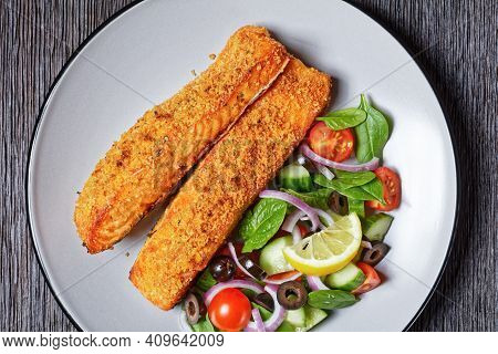Baked Salmon Fillets Breaded With Japanese Panko Crumbs Served With Vegetable Salad And Lemon Wedge