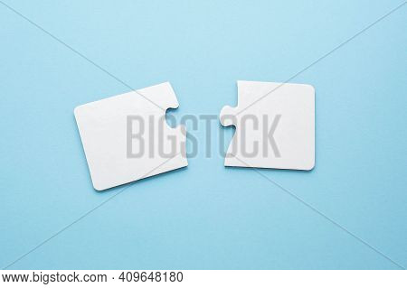Two Empty Puzzles For Text On A Blue Background