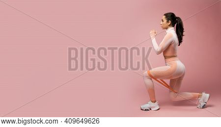 Website Header Of Sporty Young Woman Doing Exercise With Resistance Band