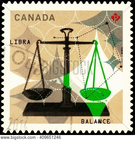 Moscow, Russia - February 22, 2021: Stamp Printed In Canada Shows Libra (balance), Series Signs Of Z