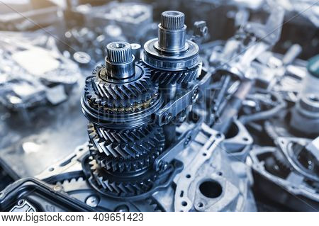 Closeup Disassembled Car Automatic Transmission Gear Part On Workbench At Garage Or Repair Factory S