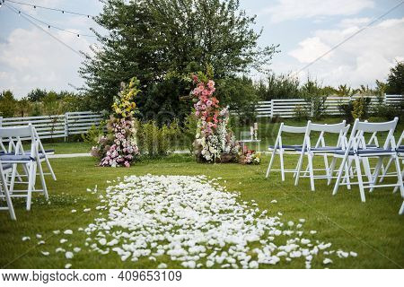 Beautiful Arch With Flowers For Wedding On Nature