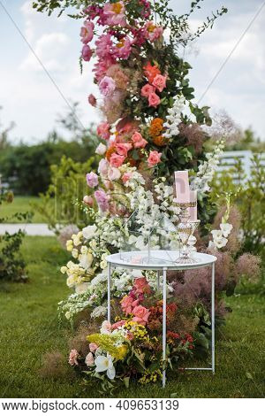Table With Glass Box On Wedding Zone Decorated With Flowers