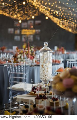 Close Up Of Buffet Table With Sweet Desserts On Wedding