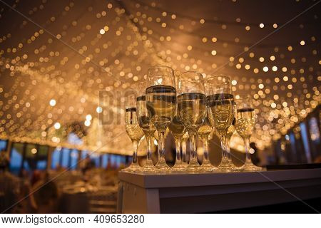 Glasses Of Cold Champagne Standing On Buffet Table