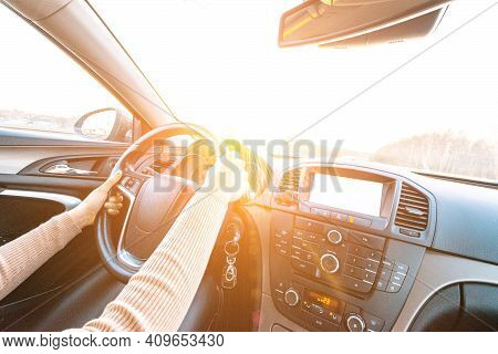 Driver Safety Road Trip. Happy Young Woman Have Fun Travel Inside Car At Sunset. Drive Winter Or Rid