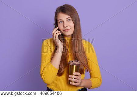Positive Female Talks With Interest And Joy Via Cellular, Wears Casual Attire, Enjoys Drinking Aroma