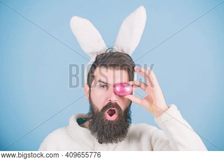 Funny Bunny With Beard And Mustache Hold Pink Egg. Bearded Man Wear Silly Bunny Ears. Easter Symbol