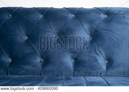 Blue Velvet Couch Background Texture With Sunken Buttons, Close Up Velvet Sofa Texture.
