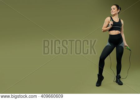Website Header Of Cheerful Young Woman With Jump Rope Standing In Studio