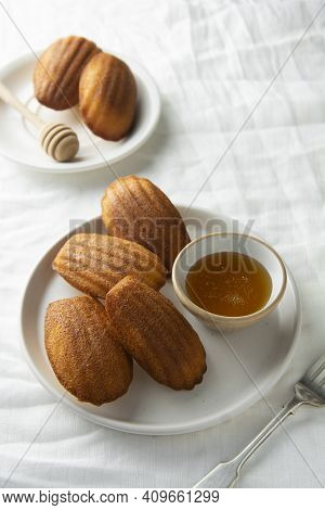 Madeleine Cakes, French Pastry. Sweet Dessert, White Textile Background, Table