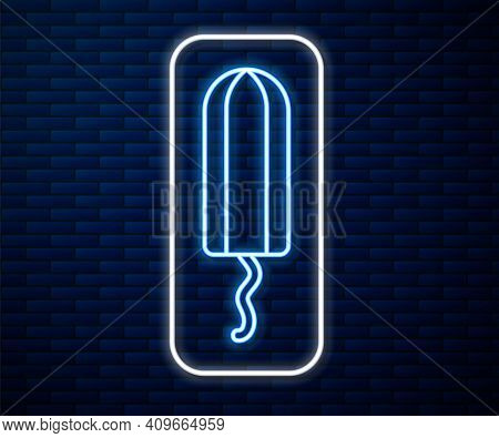 Glowing Neon Line Menstruation And Sanitary Tampon Icon Isolated On Brick Wall Background. Feminine