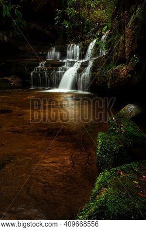 Tranquil Cascading Waterfall In Lush Bush Land In The Blue Mountains, Australia